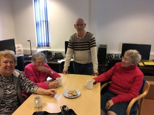 A group of VI people at a coffee morning
