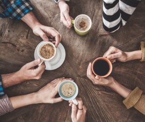 A top down view looking at people drinking coffee at a table